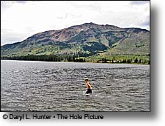 Boy swimming in the chilly waters of Heart Lake in Yellowstone's Backcountry