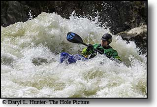 Kayaking big whitewater
