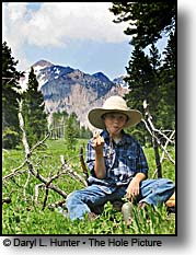 young cowboy in mountains