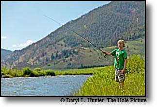 boy fly-fishing the Gallatin River