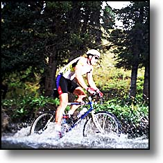 mountain biker going through creek