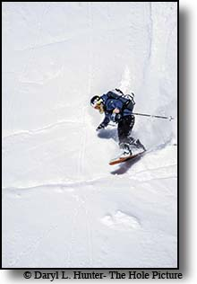 Snowboarder navigating the steeps at Teton Pass