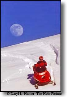 Red polaris snowmobile moon