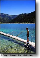 boy swimming in Upper Palisades Lake Caribou Targhee National Forest