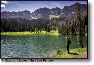 Hiker, upper Jade Lake, Absoraka mountains, Breccia cliffs, Dubois Wyoming